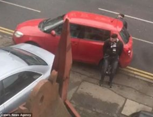 Selfish motorist parks his Audi on a stranger's driveway